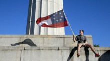 Alex, first name only, a 17 year-old student from Baton Rouge, waves a confederate flag protesting the removal of the Confederate monuments at Lee Circle in New Orleans Wednesday, February 10, 2016. (Photo by David Grunfeld, NOLA.com | The Times-Picayune) (David Grunfeld, NOLA.com | The Times-Picayune)