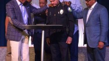 Roswell Police Department's Chief Rusty Grant and leaders from Eagles Nest Church and Zion Missionary Baptist join for prayer following recent events, including the Dallas shooting that left five of 12 injured officers dead after a sniper opened fire during a peaceful protest against police violence on Thursday, July 7.