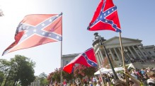 The Confederate flag, removed from public grounds in South Carolina in 2015, is a widely-reviled symbol, but still has its supporters. The design was featured on merchandise at 2016's Norfolk County Fair. (Jason Miczek/Reuters)
