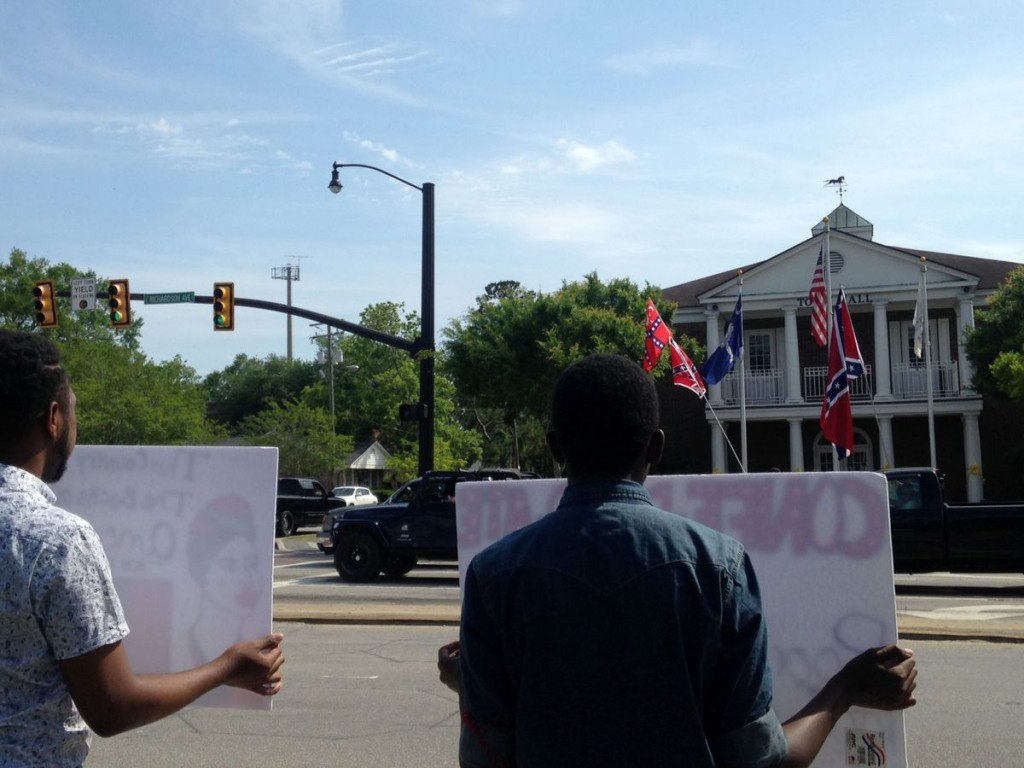 Protesters face off against flag supporters across the street.