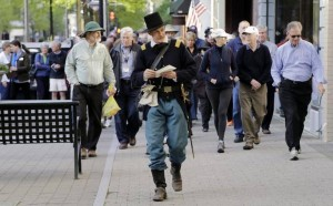 Ernest Dollar, director of the City of Raleigh Museum dressed as a Union Major, center, leads group up Fayetteville St. as he conducts a walking tour Monday, April 13, 2015 commemorating the 150th anniversary of the surrender of Raleigh to Union forces in 1865. Several other related events are scheduled for later in the day. CHRIS SEWARD CSEWARD@NEWSOBSERVER.COM