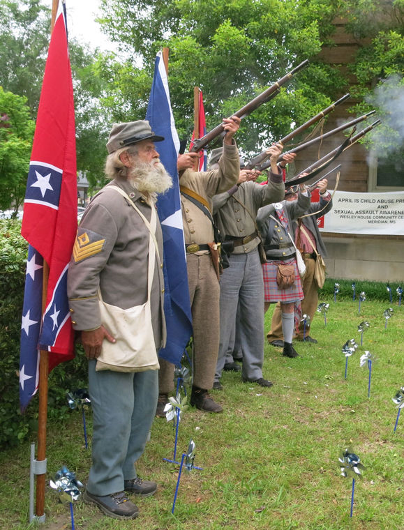 Members of the Jones County Rosin Heels 227 Sons of Confederate Veterans color guard provide a musket salute during Monday's Confederate Memorial Service at the Lauderdale County Courthouse. Members of the guard include: Donald Blanks, Coco Roberts, Carl Ford, Charles Mott, George Jaynes and Wade Purvis.