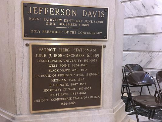 This July 20, 2017 file photo shows a plaque on a statue of Jefferson Davis in the Kentucky Capitol in Frankfort, Ky. The plaque proclaiming Davis as a hero and a patriot will be removed from Kentucky's Capitol, the latest effort to alter Confederate monuments across the country following outbreaks of racially motivated violence. The state's Historic Properties Advisory Commission voted to remove the plaque during a specially called meeting Tuesday, Oct. 24, 2017. (AP Photo/Adam Beam, file) (Photo: Adam Beam, AP)