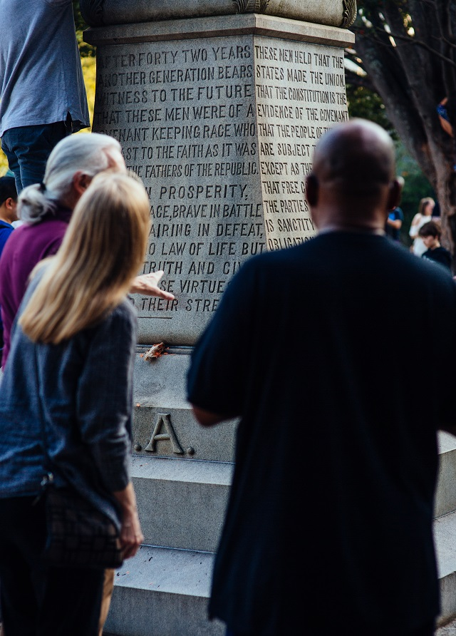 "After the Stand With Charlottesville candlelight vigil on August 13. 2017, in Decatur, Ga., attendees gather to discuss the controversial ""Lost Cause"" monument in Decatur Square."